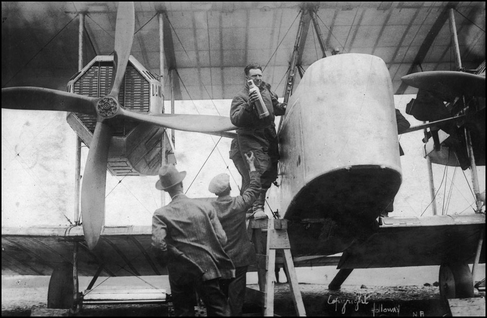 Captain_John_Alcock_stowing_provisions_aboard_Vickers_Vimy_aircraft_before_trans-Atlantic_flig...jpg