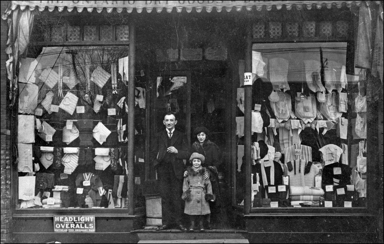 Morris Melamed, proprietor-Ontario Dry Goods & Dresses Co. at his Spadina Street shop with his...jpg