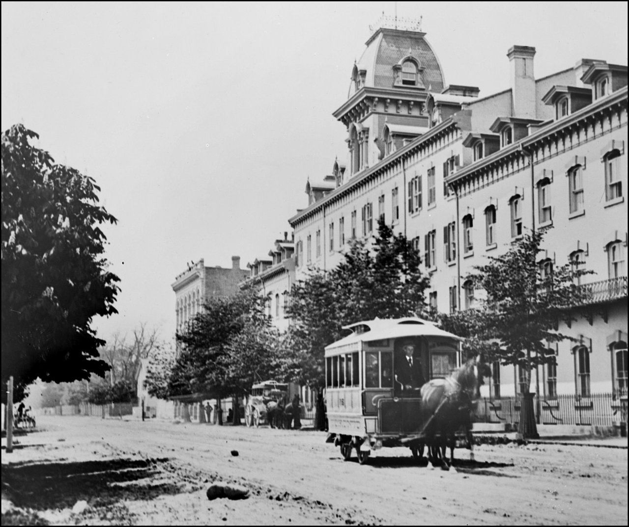 Queen's Hotel, Front St. W., north side, between Bay & York Sts. 1886   TPL.jpg
