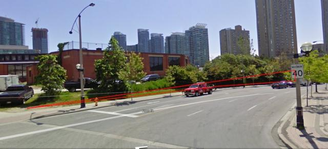 Streetview of Rees St. & Bremner Blvd with lined building mock-up.