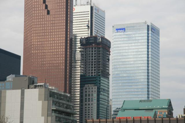 The Trump Tower is seen growing next to Scotia Plaza, Ist Canadian Place