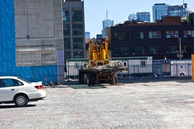 This photodepicts the arrival of construction equipment at the One Bloor site.