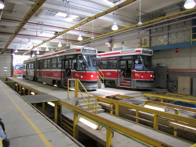Streetcars await maintenance at Roncesvalles Carhouse, image by Adam Hawkins