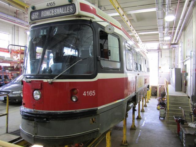 Streetcar on jacks at Roncesvalles Carhouse, image by Adam Hawkins