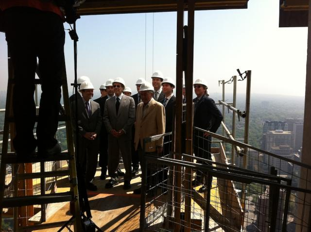 Four Seasons executives gather on 47th floor aerial loading platform for a photo