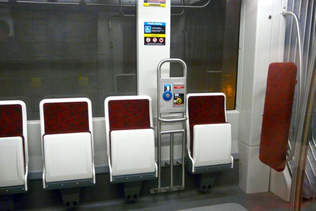 Flip-up seats mark the accessible section of the mock-up of the new TTC streetca