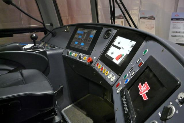 Driver's cab shows several video displays in the mock-up of the new TTC streetca