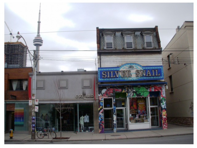 A three-storey retail building has been proposed for 265 & 267 Queen Street West