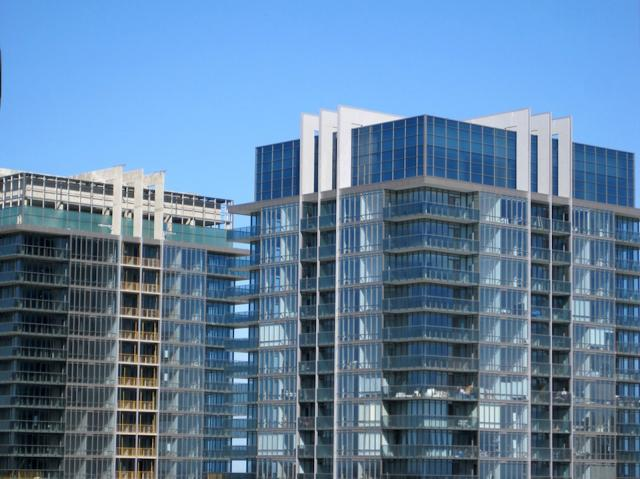 Lantern glass is being installed at South Beach condos Toronto by Amexon