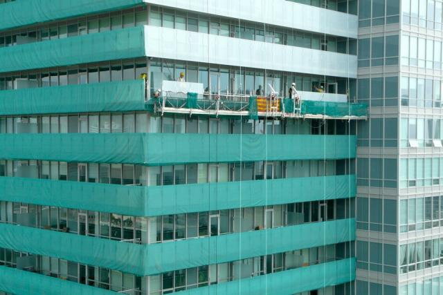 Laminated balcony glass replaces the original panels at Festival Tower, Toronto