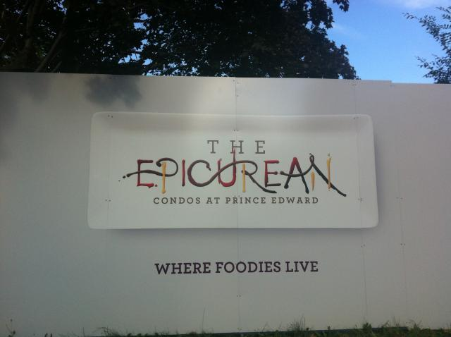 Hoarding advertising for the Monarch Group's The Epicurean