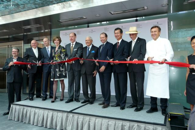 Cutting the ribbon at the opening of Toronto's new Four Seasons,