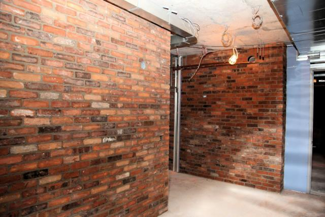 Historic red brick 6th floor hallway Daniels Corporation Kirkor Toronto