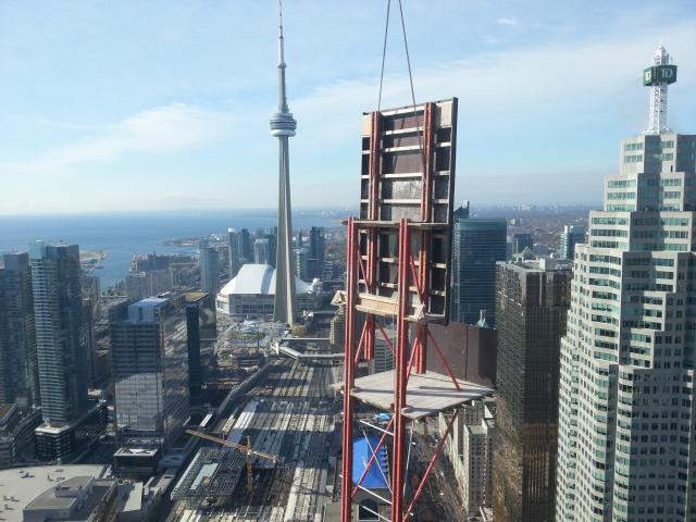 PERI RCS 'Weather wall' being craned into place above the L Tower, image by SkyJ
