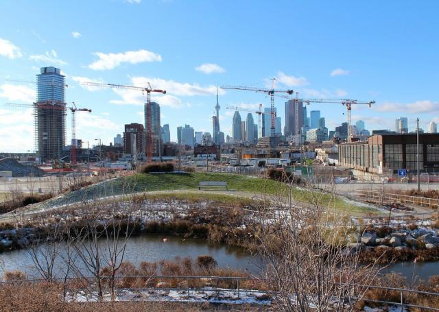 Pan Am Village cranes seen from Don River Park, image by rdaner