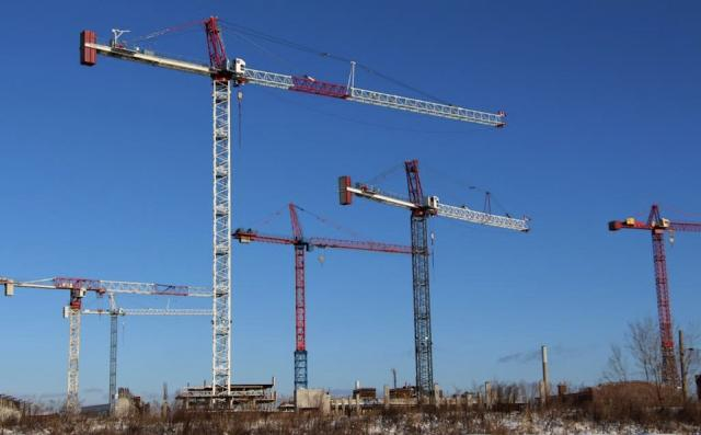 Cranes rise over construction sites in the West Don Lands, image by Razz