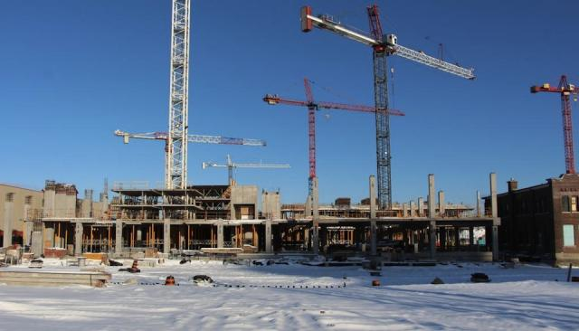 Cranes rise over the George Brown/YMCA construction site in the West Don Lands,