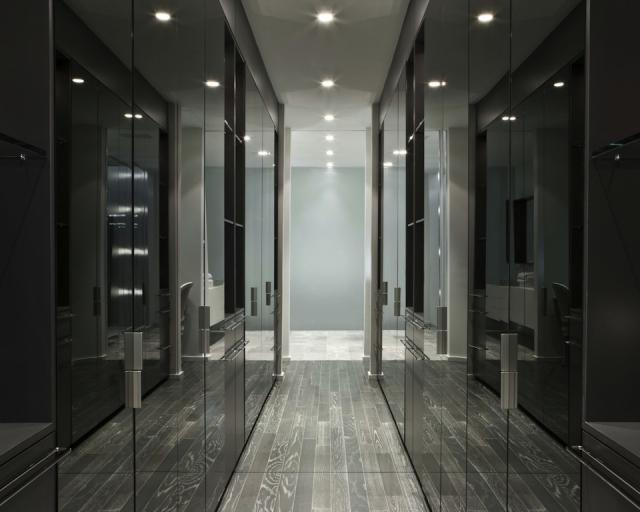 Walk-though mirror closet hall in the Model Suite at Edition Richmond, design by