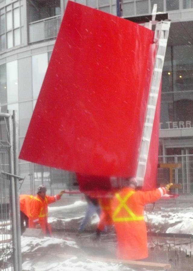 Approaching Red, being lifted, Concord CityPlace Toronto, image by Karen Mills