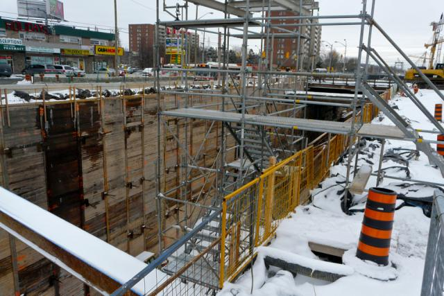 Looking north along Keele Street at station box for Finch West Station under con