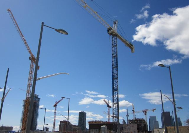 Construction cranes, Canary District, Pan Am Village, Toronto