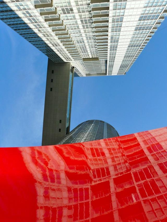 Approaching Red by Maha Mustafa reflecting Parade, Concord CityPlace Toronto