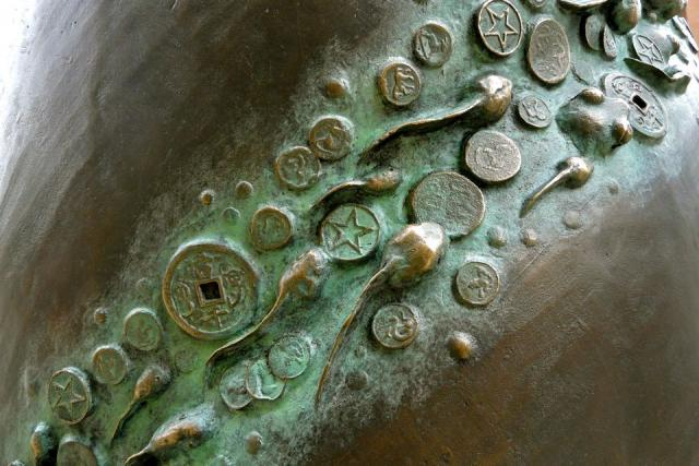 Polliwogs and ancient coins populate the spiral groove, image by Craig White