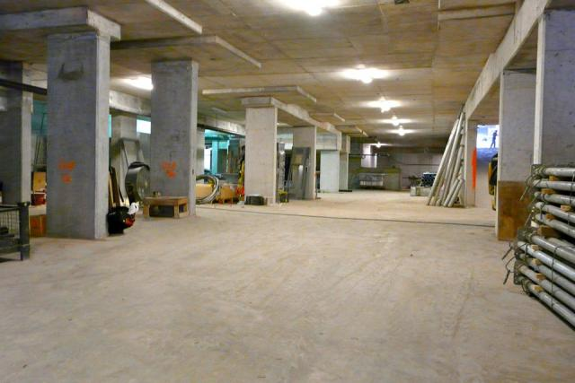 A double-height floor in the bright garage at Studio condos, Toronto