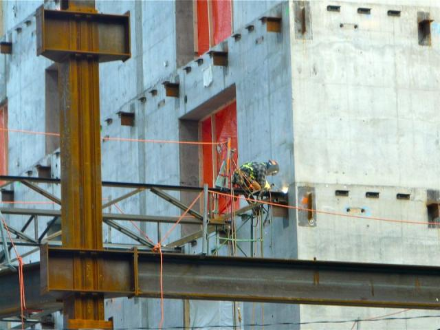 Welding a joist to the concrete core of Brookfield's Bay Adelaide East, Toronto