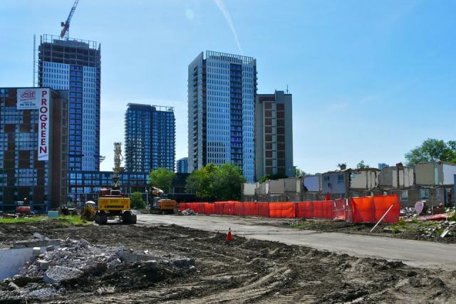 Buildings coming down for Phase 3, while Phase 2 rises behind it, Regent Park