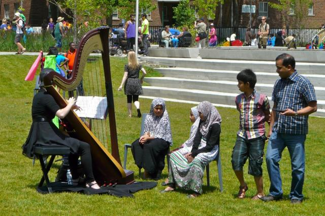 Harpist delights at the Opening of Regent Park, Toronto