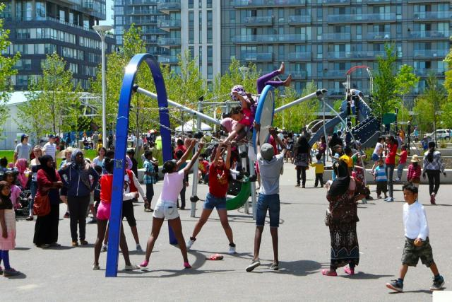Kids at the playground at the Opening of Regent Park, Toronto