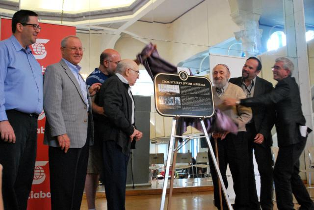 The plaque is officially unveiled, image by Marcus Mitanis.