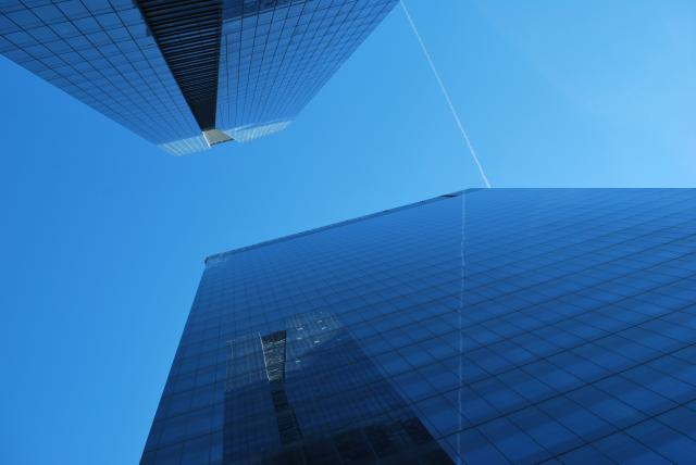 Looking up the Delta and adjacent office tower. Image by Marcus Mitanis.
