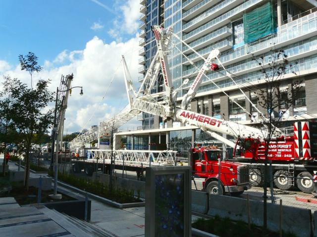 The crane mast begins to be pulled back, image by Craig White