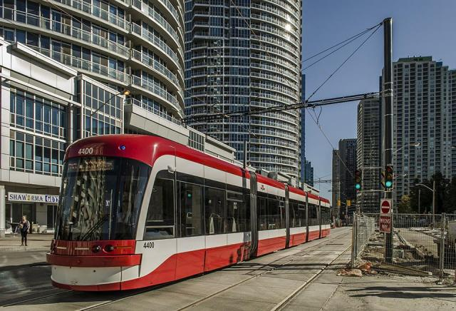A new low-floor streetcar runs on the TTC's 510 Spadina line on Queens Quay