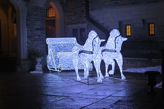 A decorative horse and carriage lights up Casa Loma, image by Marcus Mitanis