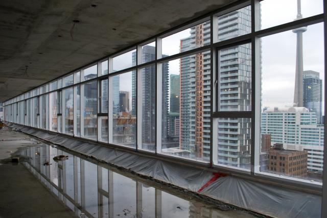 Glass installation completed on south side 17th floor, image by Marcus Mitanis
