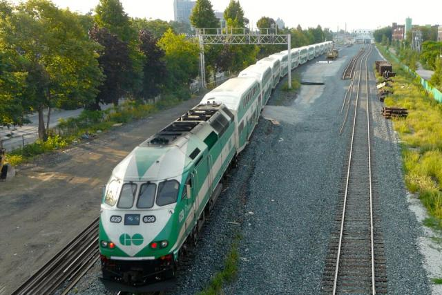 A GO Train passes work to expand services on the Georgetown South corridor