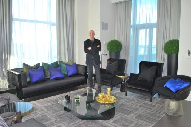 Neil Labatte poses in a Trump Residences' penthouse, image by Marcus Mitan