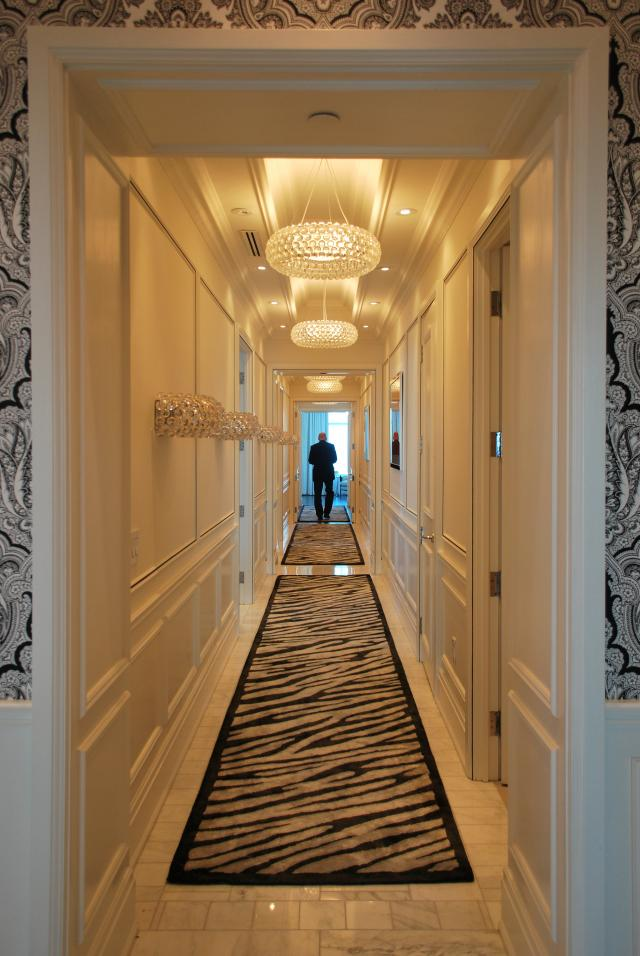 The long hallway of a Trump Residence penthouse suite, image by Marcus Mitanis
