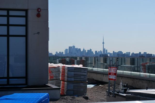Downtown Toronto seen from the rooftop terrace, image by Marcus Mitanis