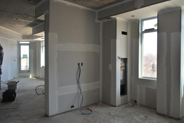 Drywall installation finishing up, image by Marcus Mitanis