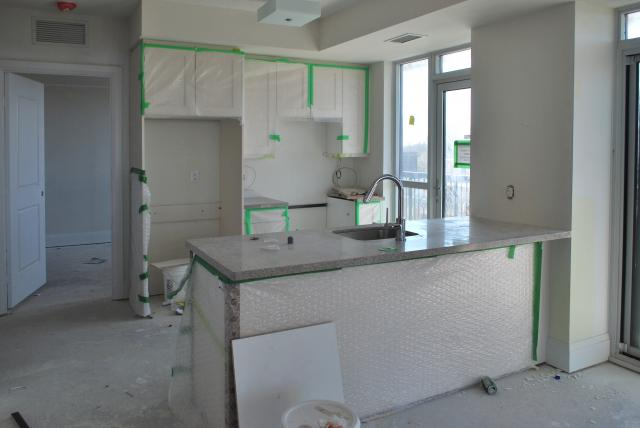 A kitchen nears completion, image by Marcus Mitanis
