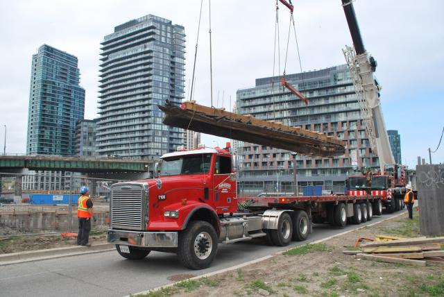 The vessel is lowered onto a flatbed truck, image by Marcus Mitanis
