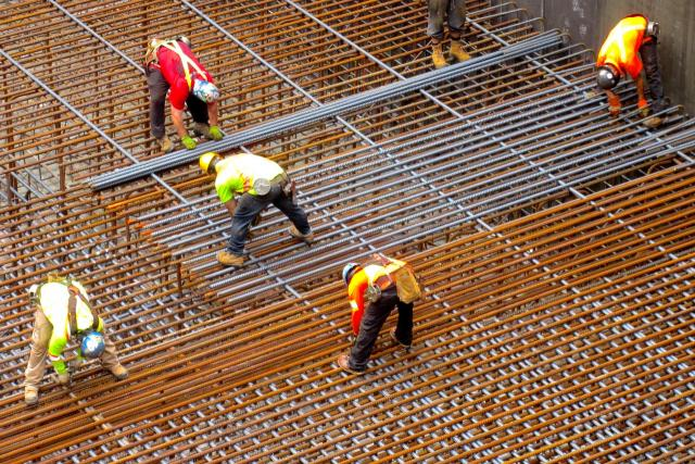 Workers lay rebar rods, Massey Tower, MOD Developments, Toronto,