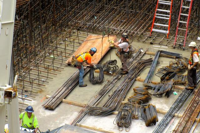 Workers receive rebar rods, Massey Tower, MOD Developments, Toronto,