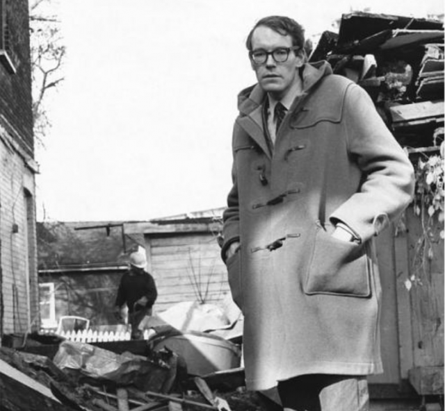 John Sewell stands in front of a demolished home, image by John Sewell