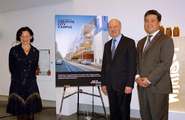 Sara Diamond, Reza Moridi, and Han Dong stand with a rendering of 100 McCaul