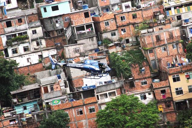 A police helicopter tries to pacify a favela in In The Shadow Of The Hill